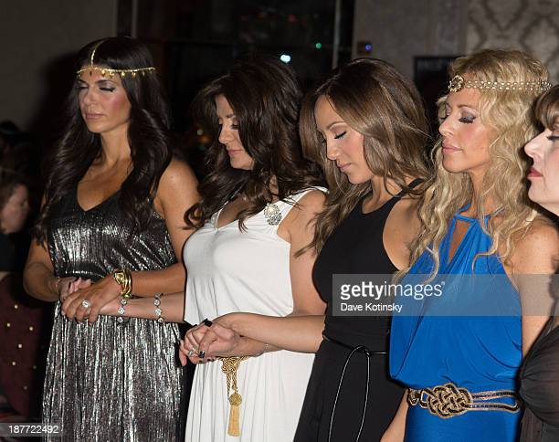 Teresa Giudice Kathy Wakile Melissa Gorga and Dina Manzo meditate at the 'Goddess Night Out' event benefiting Project Lady Bug hosted by Dina Manzo...