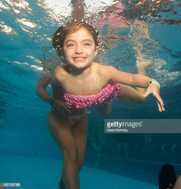 Teresa Giudice takes daughter Audriana Giudice for a swim at Majestic Resort on March 4, 2013 in Punta Cana, Dominican Republic.