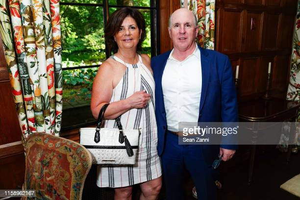 Teresa Gracie and Anthony Gracie attend A Country House Gathering To Benefit Preservation Long Island on June 28 2019 in Locust Valley New York