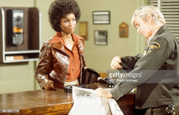 Teresa Graves and Clu Gulager appearing in the episode 'Highway to Murder' from the television show 'Get Christie Love!'.