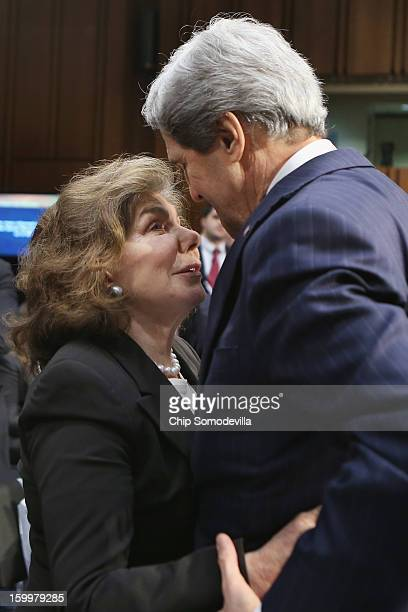 Teresa Heinz Kerry congratulates her husband Sen John Kerry after his confirmation hearing before the Senate Foreign Relations Committee to become...