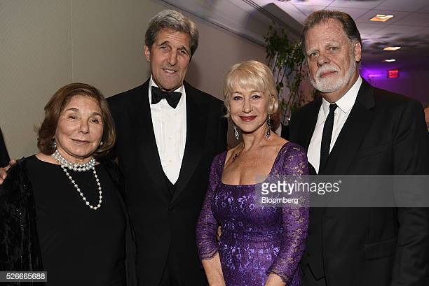 Teresa Heinz Kerry from left John Kerry US Secretary of State actress Helen Mirren and film director Taylor Hackford stand for a photograph during...