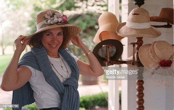 Teresa Heinz picks a hat from from her tree at her farm estate