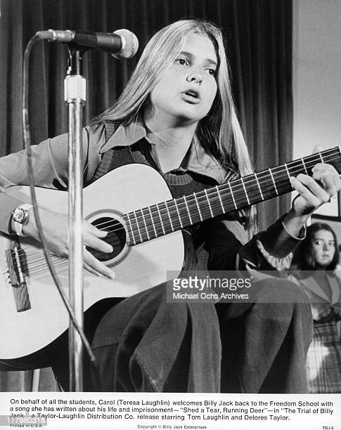 Teresa Laughlin plays song in a scene from the film 'The Trial of Billy Jack' 1974