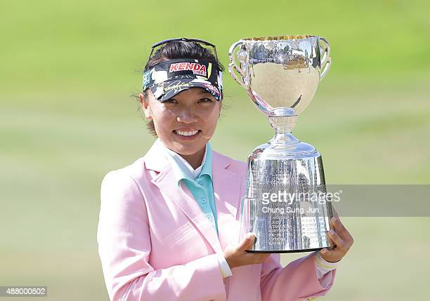 Teresa Lu of Taiwan lifts the winner's trophy during a ceremony following the 48th LPGA Championship Konica Minolta Cup 2015 at the Passage Kinkai...