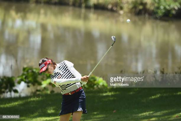 Teresa Lu of Taiwan plays her approach shot on the 14th hole during the final round of the HokennoMadoguchi Ladies at the Fukuoka Country Club Wajiro...