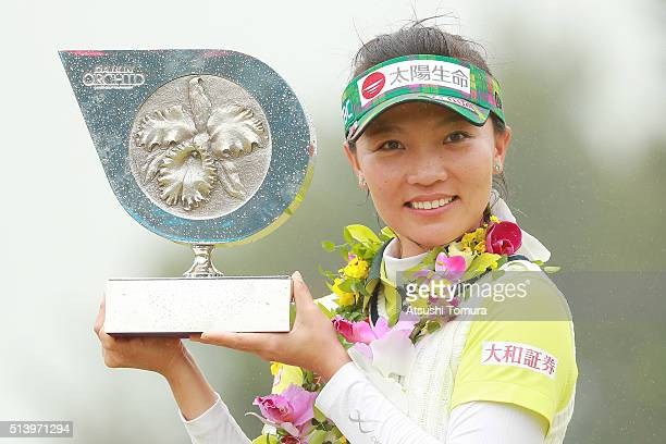Teresa Lu of Taiwan poses with the trophy after winning the Daikin Orchid Ladies Golf Tournament at the Ryukyu Golf Club on March 6 2016 in Nanjo...
