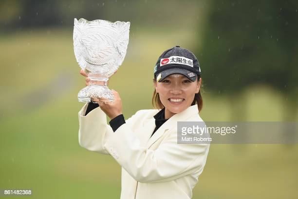 Teresa Lu of Taiwan poses with the winners trophy during the final round of the Fujitsu Ladies 2017 at the Tokyu Seven Hundred Club on October 15...