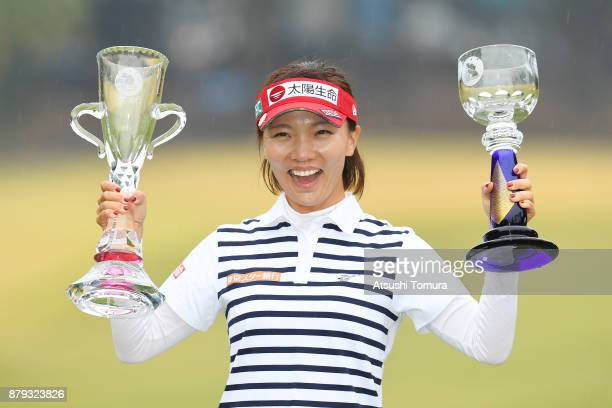 Teresa Lu of Taiwan poses with trophies after winning the LPGA Tour Championship Ricoh Cup 2017 at the Miyazaki Country Club on November 26 2017 in...