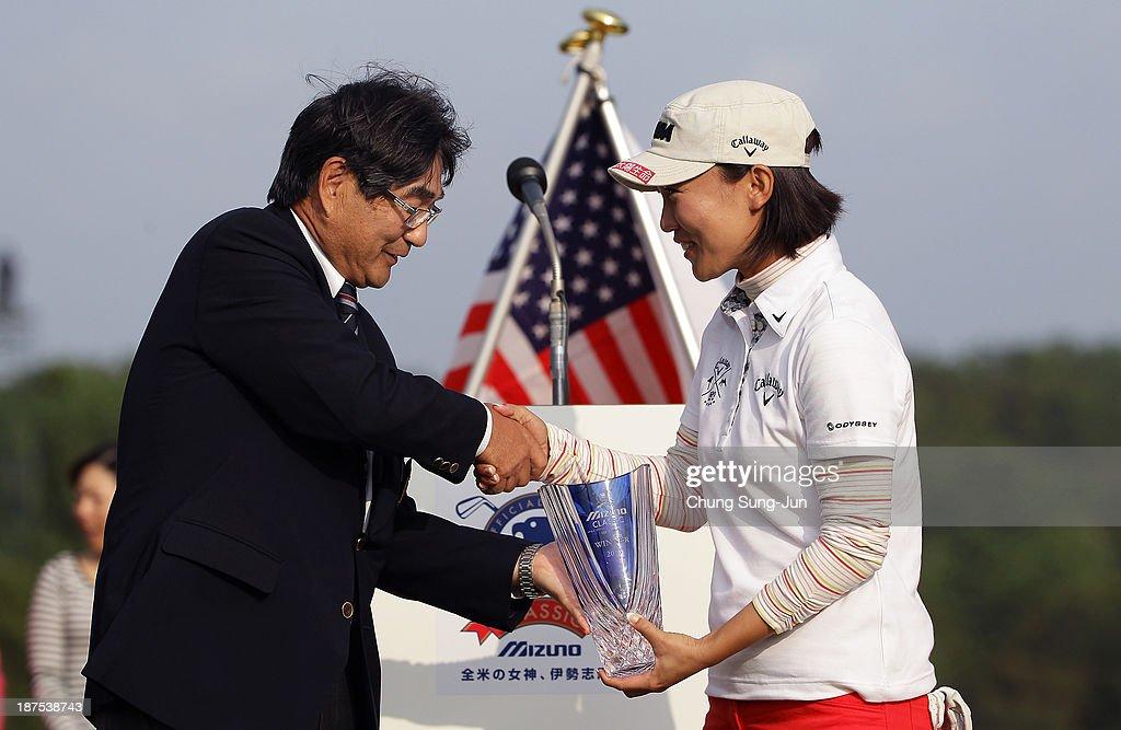 Teresa Lu of Taiwan receives the tournament trophy during the final round of the Mizuno Classic at Kintetsu Kashikojima Country Club on November 10, 2013 in Shima, Japan.