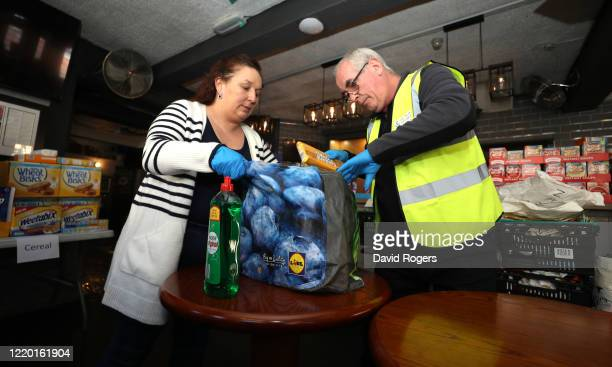 Teresa McCarthyDixon owner of the Swan and Helmet public house who set up a Food Bank on the premises for local residents and schools packs one of...