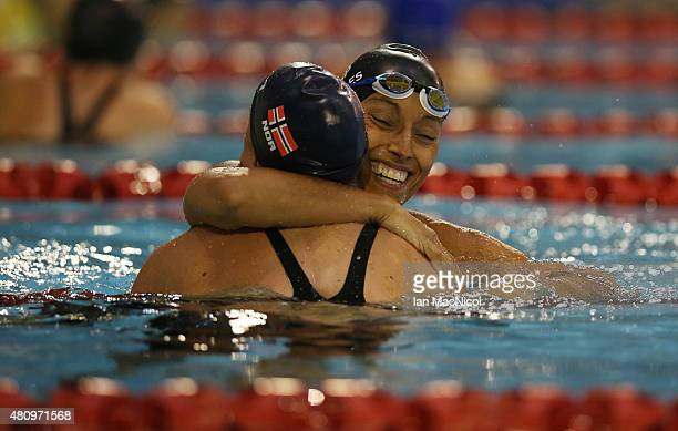 Teresa Perales of Spain congratulates Sarah Louise Rung of Norway on her victory in the Women's 50m Butterfly S5 finalduring day Four of the IPC...