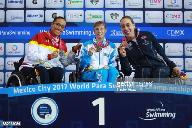 Teresa Perales of Spain silver medal Natalya Zvyagintseva of Kazakhstan gold medal and Sarah Rung of Norway bronze medal in Women's 50 m Backstroke...