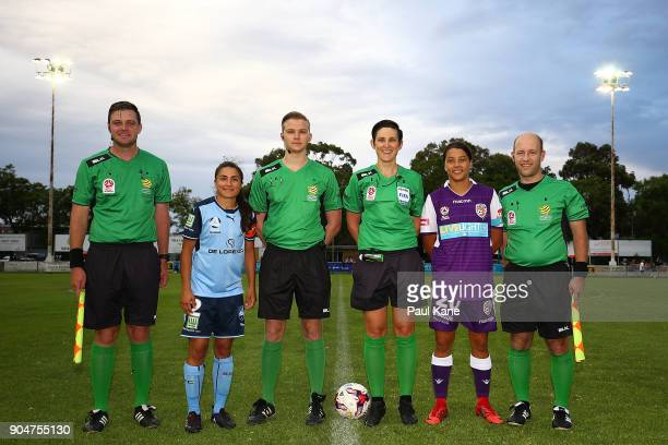 Teresa Polias of Sydney and Samantha Kerr of the Perth Glory pose with referees following the coin toss during the round 11 WLeague match between the...