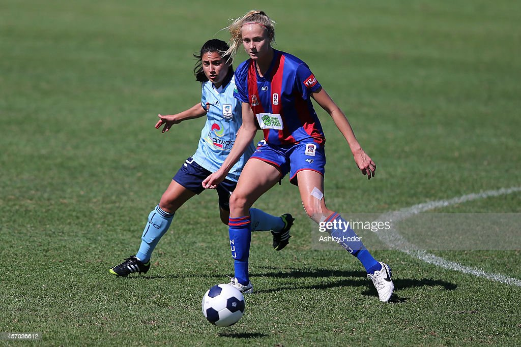 Teresa Polias of Sydney FC contests the ball against Tara Andrews of the Jets during the round five W-League match between the Newcastle Jets and Sydney FC at Magic Park on October 11, 2014 in Newcastle, Australia.
