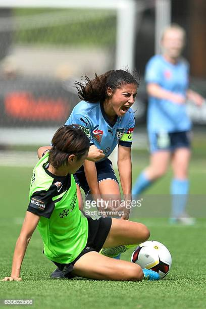 Teresa Polias of Sydney is tackled by Yukari Kinga of Canberra during the round 10 WLeague match between Sydney and Canberra at Lambert Park on...