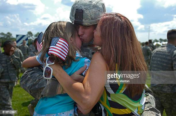 Teresa Reilly and daughter Amber Reilly greets her son Spc. William Terry with the U.S. Army's 2nd Brigade Combat Team, 3rd Infantry Division during...