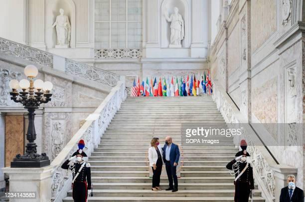 Teresa Ribera , Spanish Deputy Prime Minister, seen greeting Italian Minister for Ecological Transition Roberto Cingolani . Italian Minister of the...