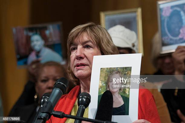 Teresa Rousseau holds a photo of her daughter Lauren Rousseau who was a substitute teacher when she was killed at Sandy Hook Elementary School nearly...