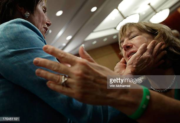 Teresa Rousseau , the mother of school teacher Lauren Rousseau who was killed during the Sandy Hook Elementary School shooting, is hugged by House...