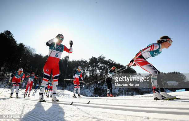 Teresa Stadlober of Austria and Marit Bjoergen of Norway compete during the Ladies' 30km Mass Start Classic on day sixteen of the PyeongChang 2018...