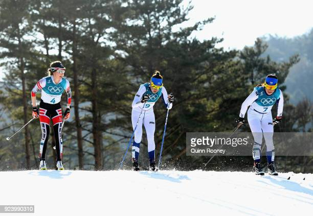Teresa Stadlober of Austria Kerttu Niskanen of Finland and Krista Parmakoski of Finland compete during the Ladies' 30km Mass Start Classic on day...