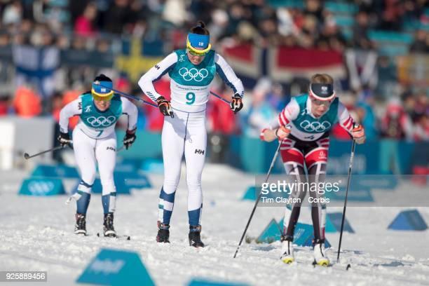Teresa Stadlober of Austria Kerttu Niskanen of Finland and Krista Parmakoski of Finland in action during the CrossCountry Skiing Ladies' 30km Mass...