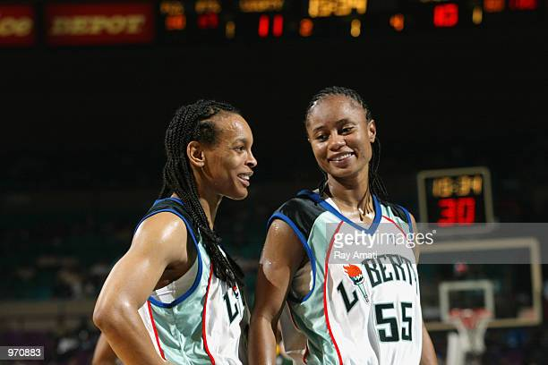 Teresa Weatherspoon and Vickie Johnson of the New York Liberty smile during the game against the Seattle Storm on July 7 2002 at Madison Square...