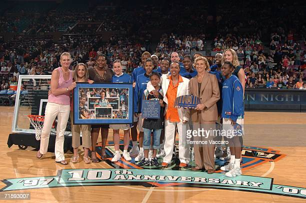 Teresa Weatherspoon formerly of the New York Liberty poses at the center of the court with former teammates Kym Hampton Sue Wicks General Manager...
