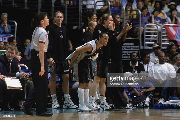 Teresa Weatherspoon of the New York Liberty cheers her team on from the bench during Game 2 of the 2002 WNBA Finals against the Los Angeles Sparks on...