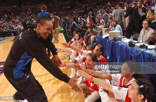Teresa Weatherspoon of the New York Liberty of the Eastern Conference AllStars shakes some kids hands prior the 2003 WNBA AllStar Game on July 12...