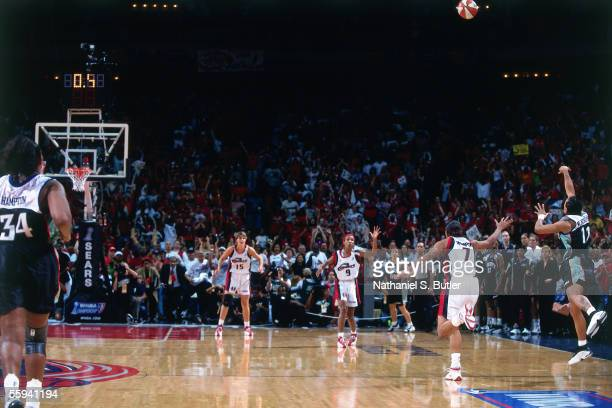 Teresa Weatherspoon of the New York Liberty shoots from half court to beat the Houston Comets in Game 2 of the 1999 WNBA Finals at the Compaq Center...