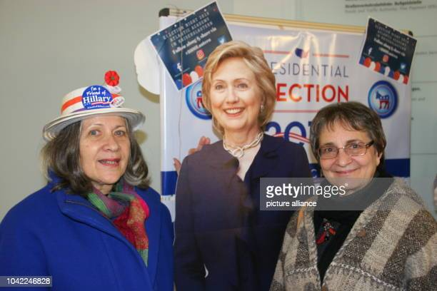 Terese Sarno and Amy Peaceman pose with a cardboard likeness of US democratic presidential candidate Hillary Clinton at the US presidential election...