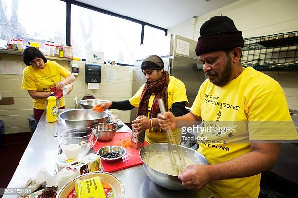 Terese Tolak Naznin Sultana and Sharuk Syed in the kitchen of the Yonge St Mission Christian Community Centre baking cookies and cupcakes for a bake...
