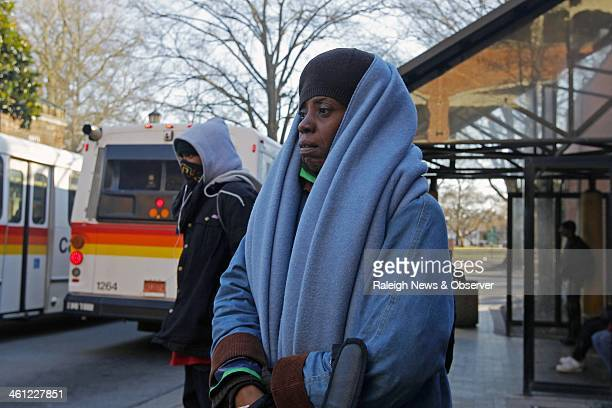 Teressa Ann Simmons bundles up as she waits for a bus at Moore Square Station in Raleigh NC Tuesday Jan 7 2014