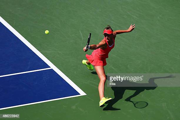 Tereza Smitkova of Czech Republic returns a shot to Madison Keys of the United States during their Women's Singles Second Round match on Day Three of...