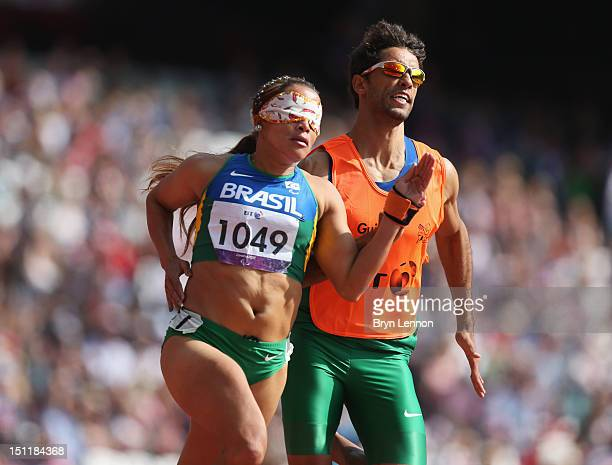 Terezinha Guilhermina of Brazil and her guide Guilherme Soares de Santana compete in the Women's 400m T12on day 5 of the London 2012 Paralympic Games...