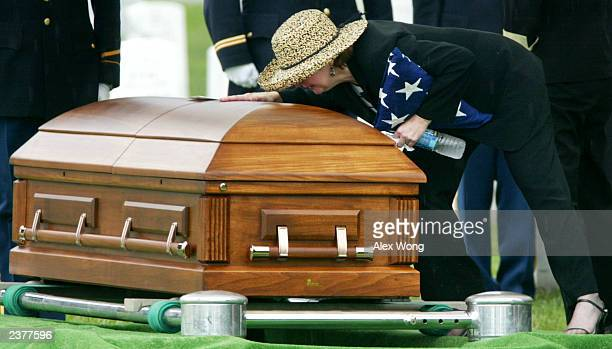 Teri Christian mother of US Army Specialist Brett Christian touches the casket of her son during his funeral at the Arlington National Cemetery...