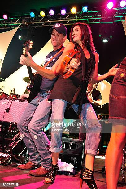 Teri Hatcher performs with James Denton at the 2nd Annual Band From TV Night at the Flyers Baseball Game on July 26 2008 in Fullerton California