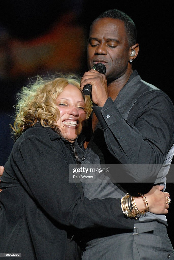 Terika Gilliam (L) a Twitter follower of Brian McKnight (R) joins McKnight onstage at Masonic Temple Theater on November 23, 2012 in Detroit, United States.