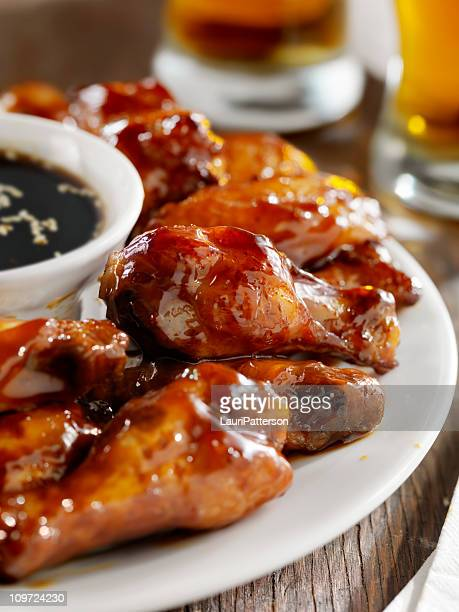 teriyaki chicken wings and beer - chicken wings stock pictures, royalty-free photos & images