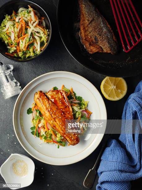 teriyaki seabass with oriental slaw - japanese food stock pictures, royalty-free photos & images