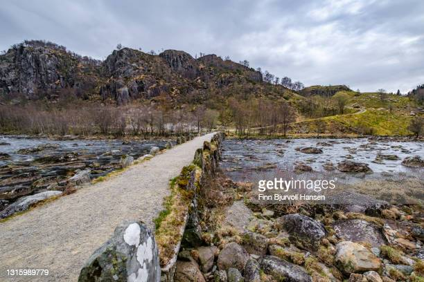 terland  klopp stone bridge in norway. stone slab bridge from the early 19th century - finn bjurvoll stock pictures, royalty-free photos & images