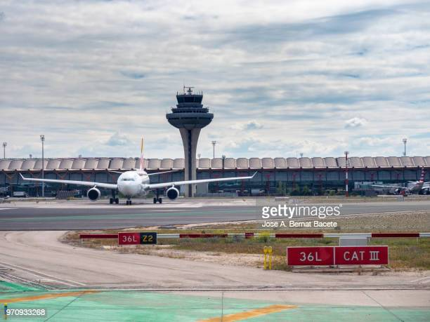 terminal building and tower of control of the airport with planes in the track. madrid, spain. - lax airport stock pictures, royalty-free photos & images