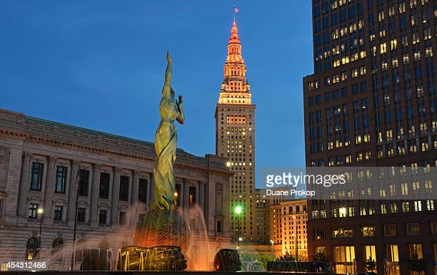 Terminal Tower lit with orange red and yellow in support of Stand Up To Cancer on August 28 2014 in Cleveland United States