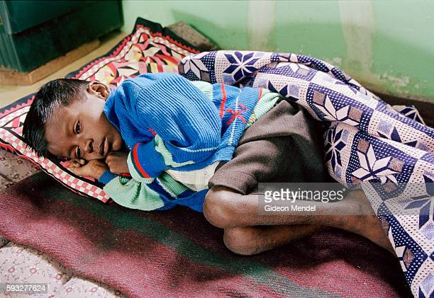 A terminally ill child at rest one among 35 children who live in Arulagam Hospice All of the children have been affected by AIDS some are orphans of...