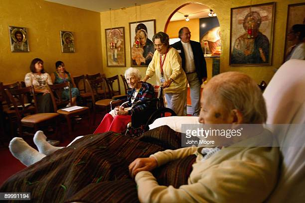 Terminally ill hospice patient Helen Kress is wheeled through the chapel following a service at the Hospice of Saint John on August 21 2009 in...