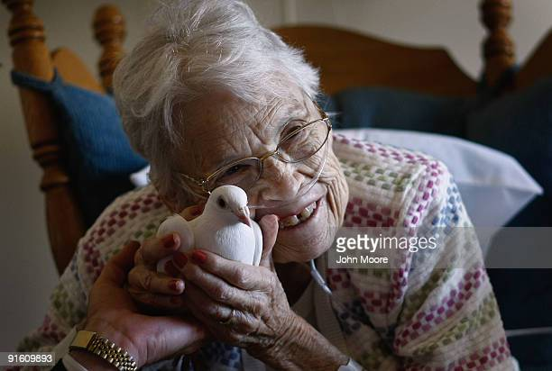 Terminally ill patient Evelyn Dafoe caresses a dove on October 7 2009 at the Hospice of Saint John in Lakewood Colorado The dove visits are part of...