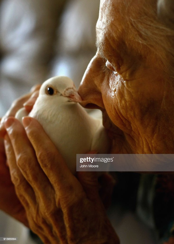 Terminally ill patient Jackie Beattie, 83, holds a dove on October 7, 2009 while at the Hospice of Saint John in Lakewood, Colorado. The dove releases are part of an animal therapy program designed to increase happiness, decrease loneliness and calm terminally ill patients during the last stage of life. The non-profit hospice, which serves on average 200 people at a time, is the second oldest hospice in the United States. The hospice accepts patients regardless of their ability to pay, although most are covered by Medicare or Medicaid. End of life care has become a contentious issue in the current national debate on health care reform.