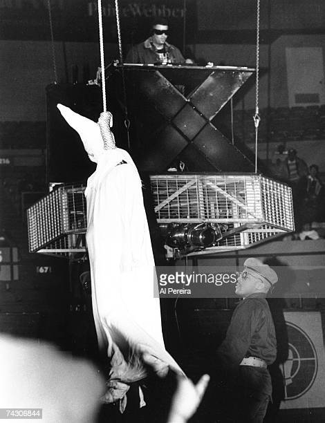 Terminator X of the rap group 'Public Enemy' performs onstage as his band mate Professor Griff lynches a dummy wearing a Klu Klux Klan outfit in...
